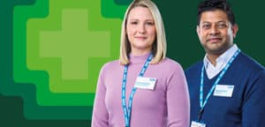 Two pharmacy team members